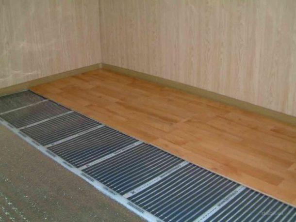 Укладка ламината на плёночный тёплый пол