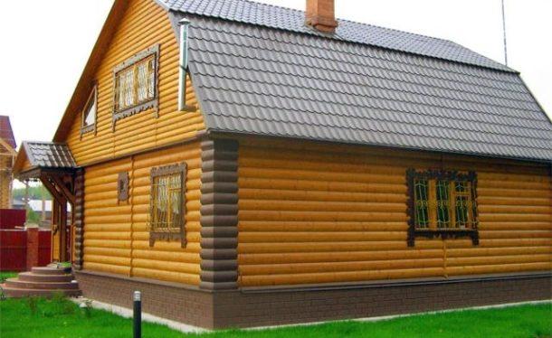 Отделка фасада частного дома деревянным сайдингом